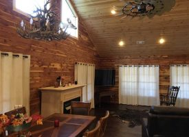 Gorgeous Cedar Log Cabin, Hardwood floors, 2 bed 2 bath, metal roof, shop sitting on 5 +/- Acres, Cave City, AR, Sharp County